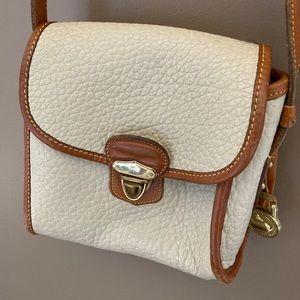 Dooney and Bourke vintage cream tan crossbody bag